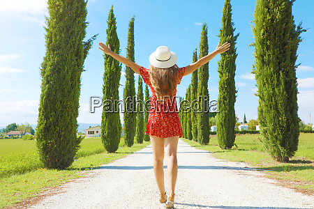 flying in tuscany concept young woman
