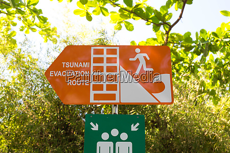 tsunami roadsign pointing towards the stunami