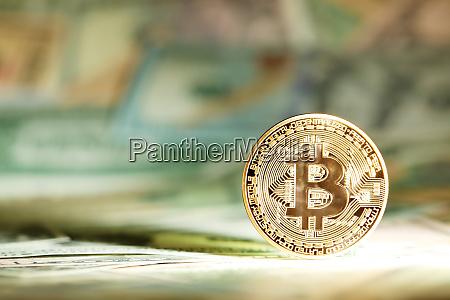 shiny bright golden bitcoin balanced on