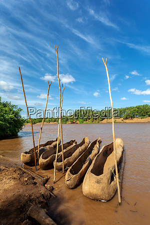 wooden coarse boat on mystical omo