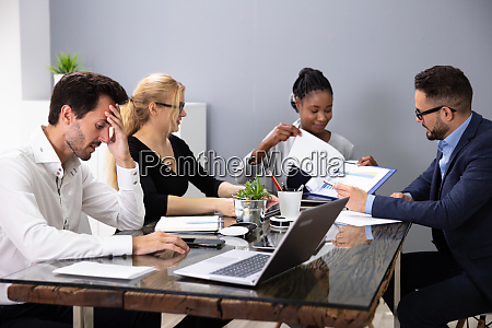 bored manager sitting at presentation in