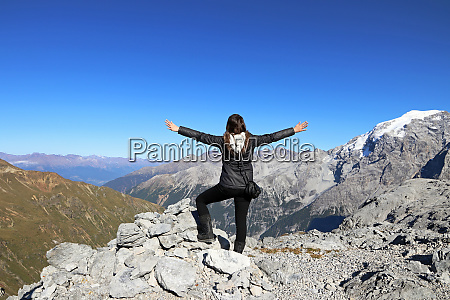 a woman in the mountains stretches