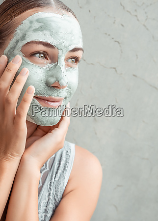 happy woman doing mask of a