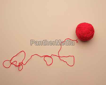 clew with red woolen thread on