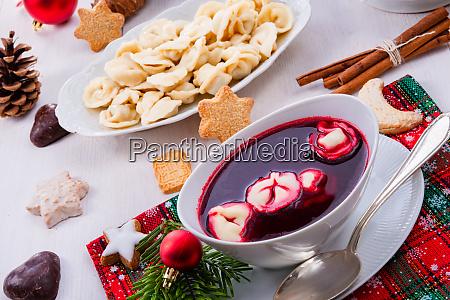 barszcz beetroot soup with small pierogi
