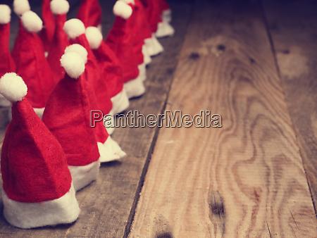 many hats of santa on a