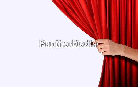 hand holding curtain over white background