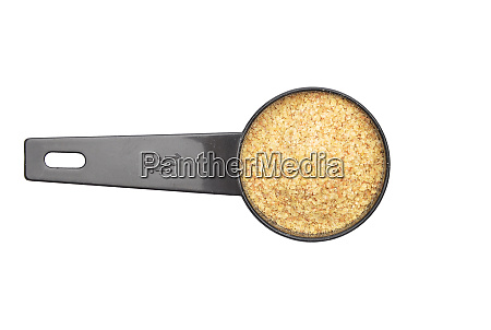 wheat germs in measuring spoon on