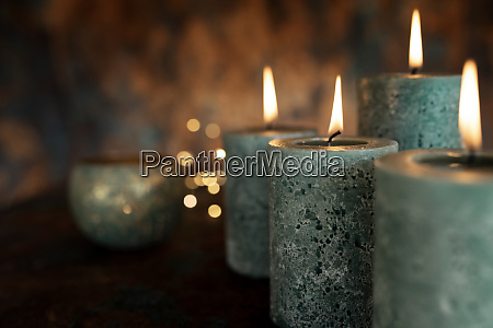 advent candles burning at darkness