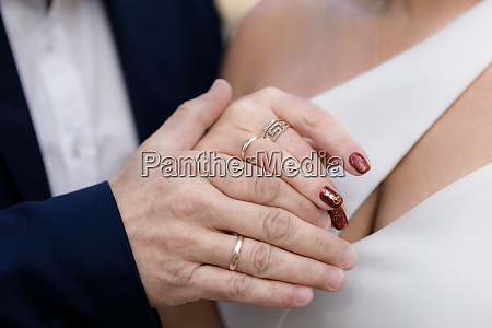 wedding rings on the hands of