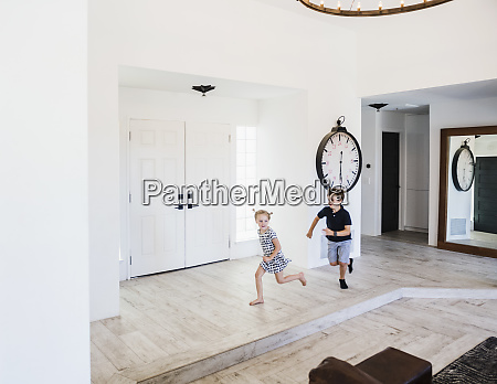 boy chasing his sister in entrance
