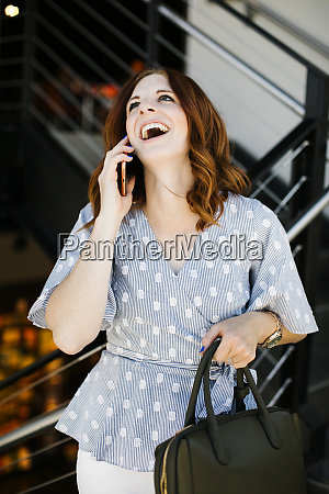 laughing mid adult woman on phone