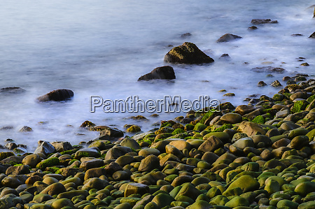 long exposure shot of rock beach