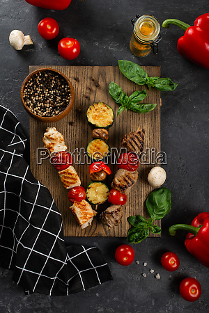 grilled skewers on cutting board with