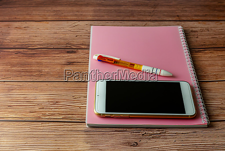 smart phone mobile with notebook on