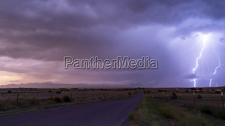 farm road rural country storm passing