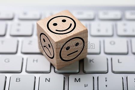 service satisfaction survey dice on keyboard