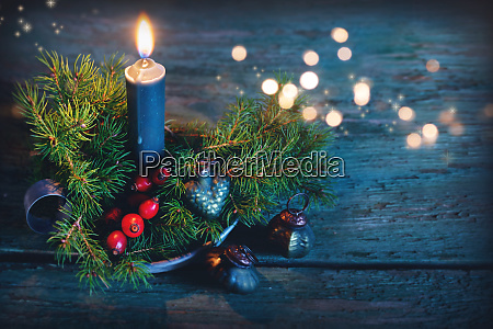 candle with christmas ornaments