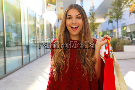 happy cheerful woman with red poncho