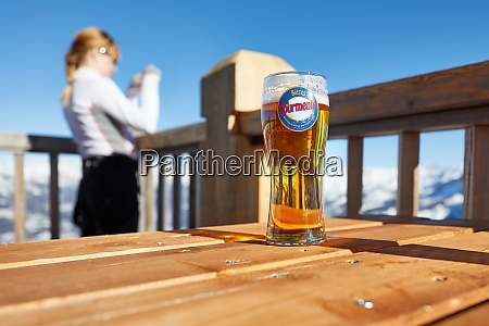 having a beer on a terrace