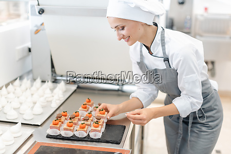 paitssier putting petite fours on a