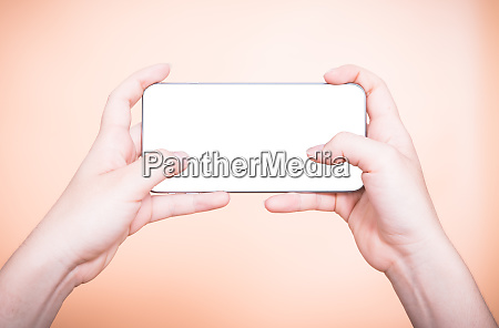 female hand holding mobile smartphone play