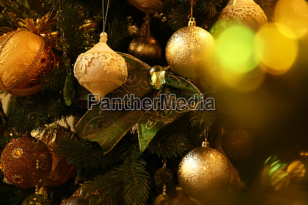 close up christmas tree decorations hanging