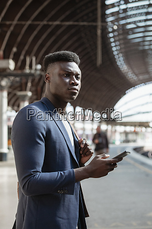 businessman waiting for a train