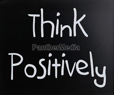 think positively handwritten with white chalk