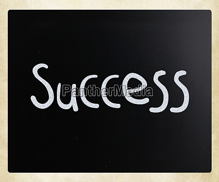 the word success handwritten with white