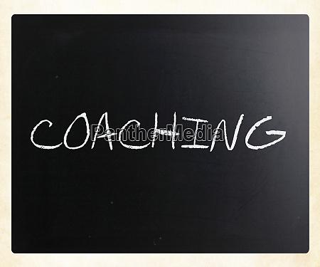 coaching handwritten with white chalk on