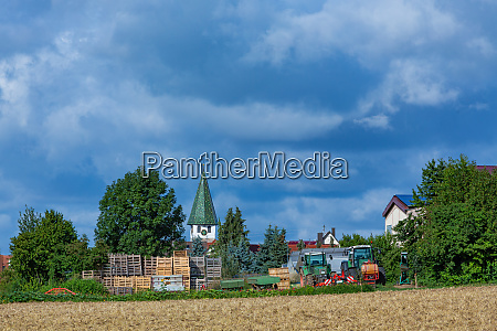 rural scene with church tower and