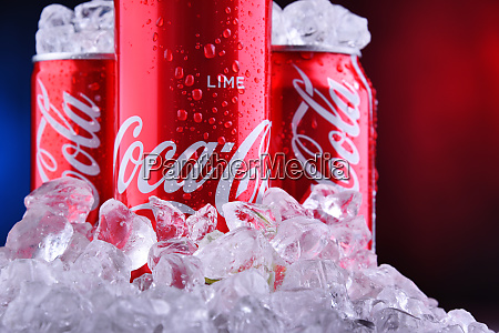 cans of coca cola with crushed