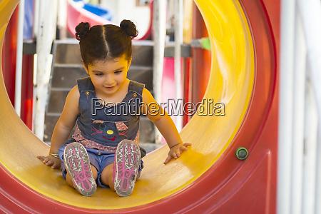 a little girl having fun inside