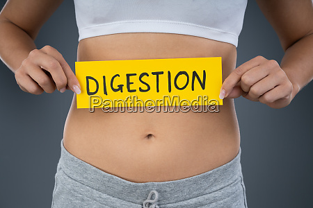 woman with stomach pain showing digestion