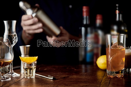 barman mixing cocktails in a martini