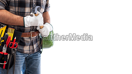 carpenter with work tools on a