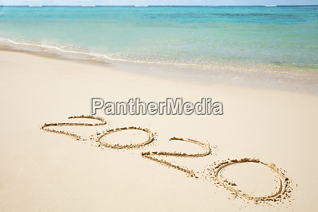 2020 year written on sand near