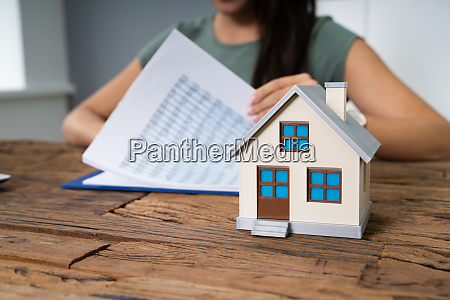 house model and papers