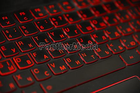 red led light computer laptop keyboard
