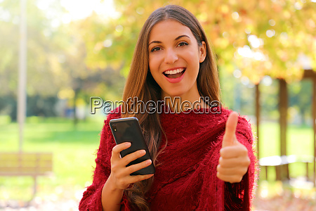 attractive fashion woman using smart phone