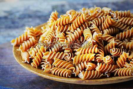 wholemeal fusilli in a plate integral