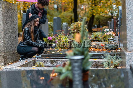 couple in grief on a cemetery