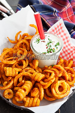 basket full of curly fries