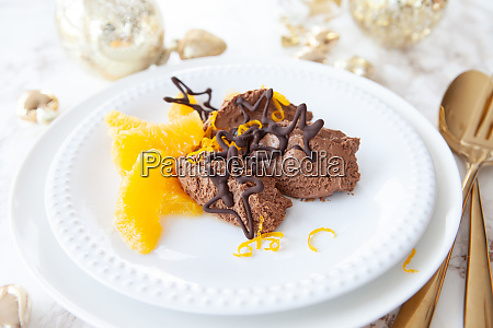mousse au chocolat with orange slices