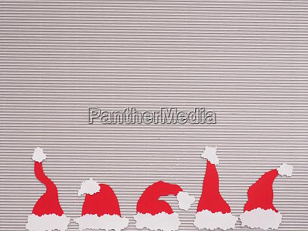 five handmade hats of santa on