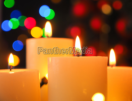 four burning advent candles with christmas