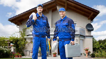 two male electrician in front of