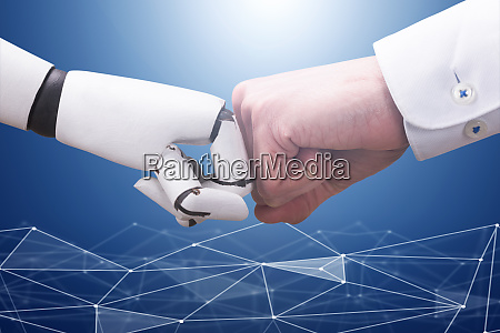 robot and businessmans hand making fist