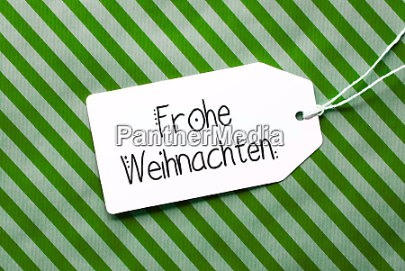 green wrapping paper label frohe weihnachten